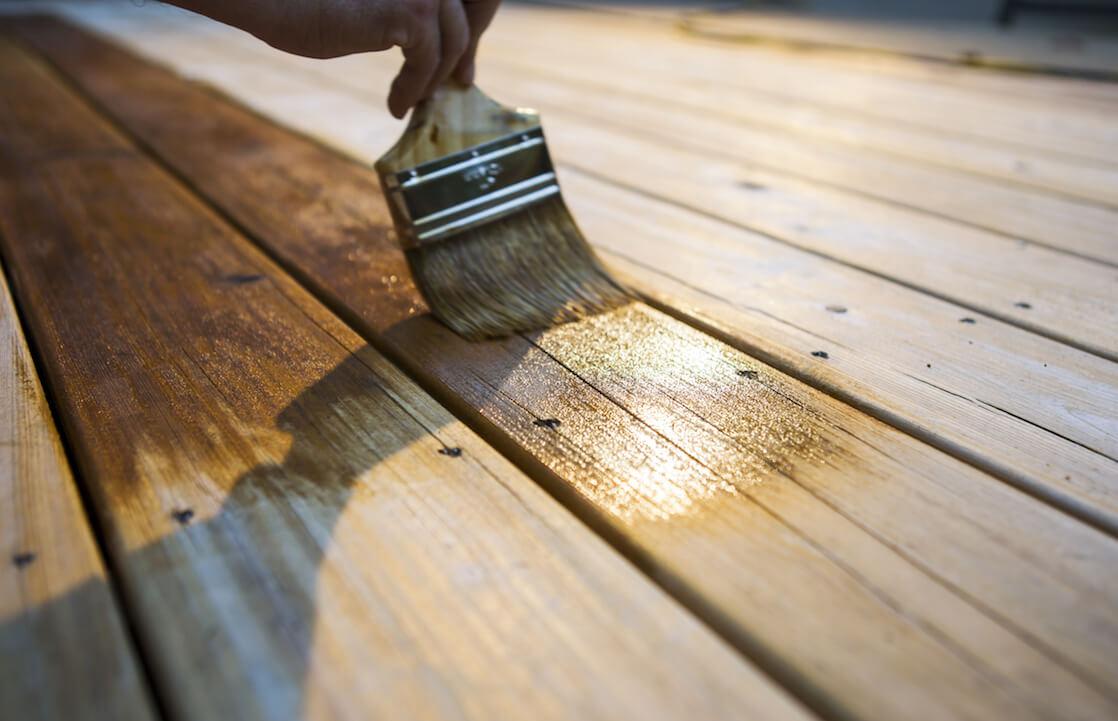 Person Oiling Porch
